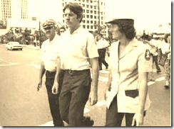 Michael Egan escorted by police after resigning and throwing away his police hat at IWD March 1979