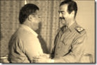 Photo of Jalal Al-Talabani agreeing to be allied with Saddam Hussein in late 1982