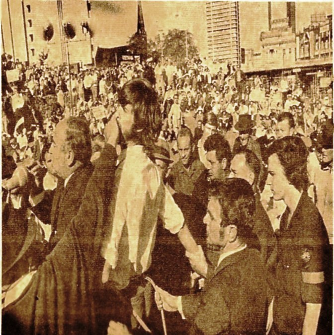 Waterside Worker, Phil O'Brien holding Brian Laver's right wrist in an attempt to prevent him from mounting the platform of the Vietnam Moratorium in May 1970.  George Georges is at the microphone in front of the bearded Laver. Phil O'Brien was a rank and file wharfie and member of the Waterside Workers Federation. Claims that CPA unionists gagged and physically restrained him were not entirely accurate. Phil O'Brien was never a member of the CPA (see below).