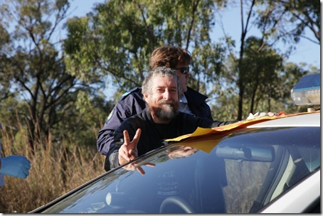 Police arrest Jim Dowling for blocking military access to the Talisman Sabre training facility.