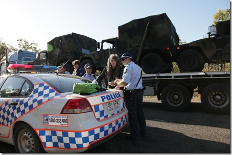 Police arrest Ciaron O' Reilly for blocking military access to the Talisman Sabre training facility.