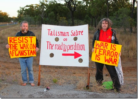 Veteran members of the Catholic Worker movement Jim Dowling and Ciaron O'Reilly prepare to block a major access road to the Talisman Sabre military exercise