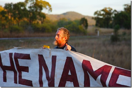 Veteran member of the Catholic Worker movement Jim Dowling prays before preparing to block a major access road to the Talisman Sabre military training facility