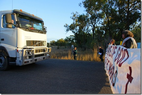Members of the Catholic Worker movement along with fellow peace activists blocking military vehicles on a major access road to the Talisman Sabre war games exercise area in Shoalwater Bay, QLD