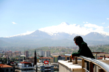 Iranian refugee Siavash stands on a terrace in Kayseri on May 4, 2010
