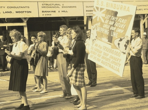 Folk Singers in the Seamens Union contingent of the 1965 Labour Day march - Photo: Garner, Grahame. 'Images documenting radical protest and street marches in Brisbane , 1960-1980.' F3400. Fryer Library, University of Queensland