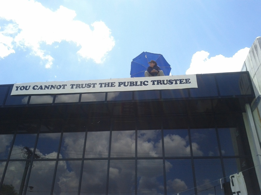 Man on Roof to Challenge Bank Sale of CommunityCentre
