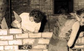 margot and pic laying bricks for Zed studio at UQ