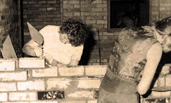 Photo: Gordon Curtis. Taken most likely in November or October 1975 inside the original studios in the basement of U of Q Students Union complex. Margot Foster and Pic (Brenda Mattick) are laying bricks.