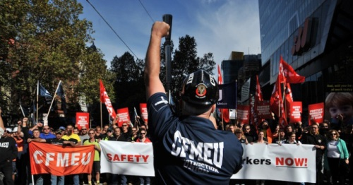 Construction workers march in the city centre in Melbourne, Tuesday, April 30, 2013. The CFMEU today marched on Grocon sites calling for improved safety. (AAP Image/Julian Smith) NO ARCHIVING