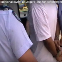 Police arrest traditional owner for defending the sacred fire on Jagera Land