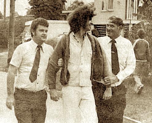 Ian Curr's (middle) arrest by Det Pat Glancy (left) at GU